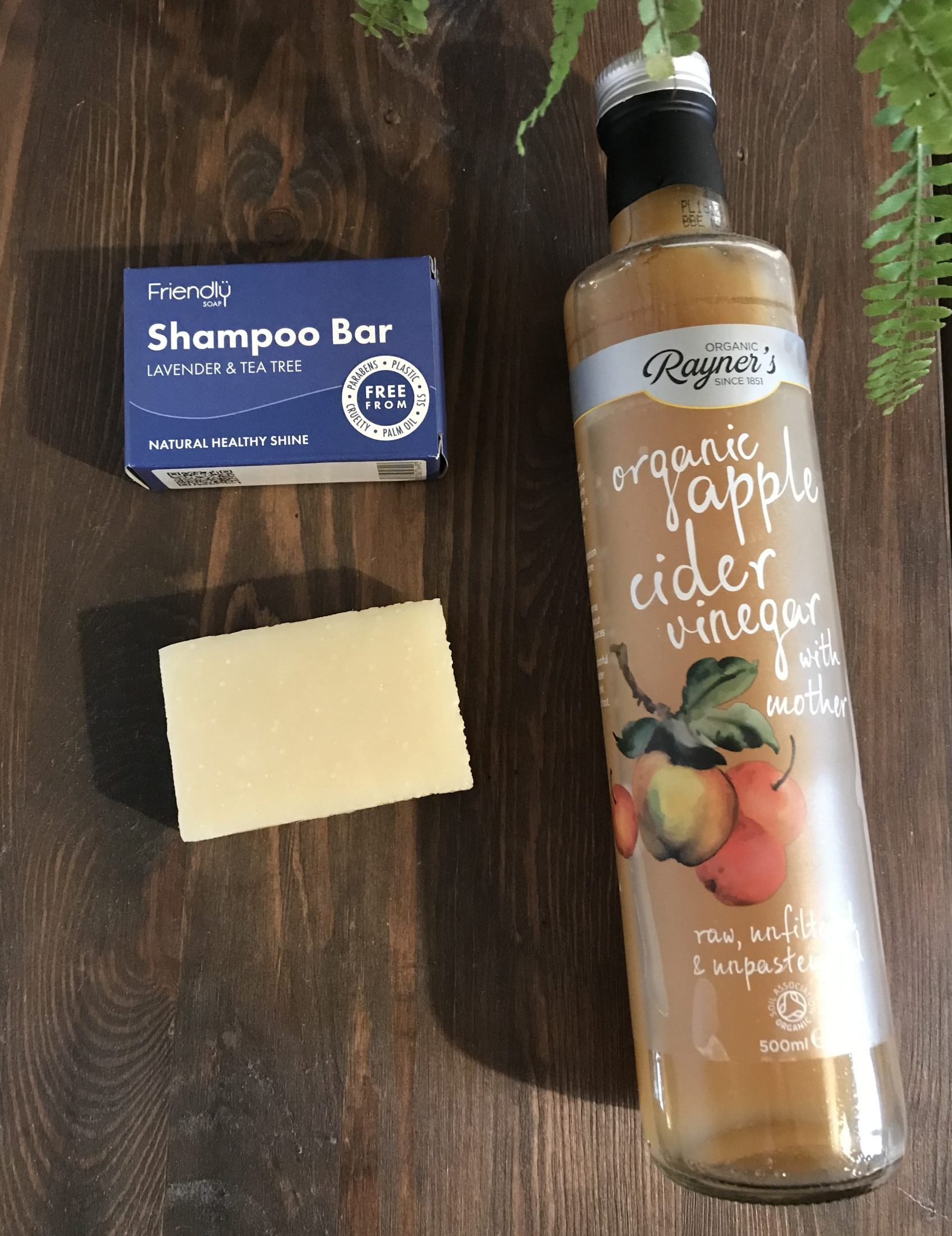 Solid shampoo bar and apple cider vinegar for shampoo bar transition period.