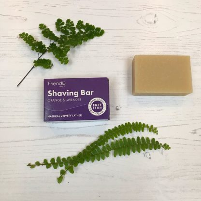 A bar of natural shaving soap with cardboard packaging by Friendly Soap
