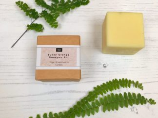 Bain & Savon sunny orange shampoo bar with cardboard box packaging