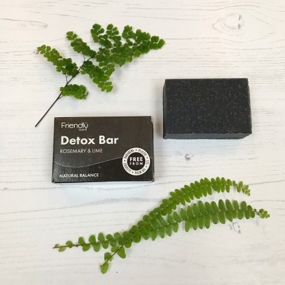 A bar of natural charcoal detox soap with cardboard packaging by Friendly Soap