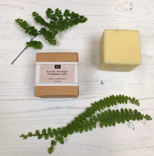 Bain & Savon sunny orange shampoo bar with cardboard box packaging