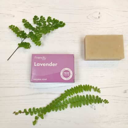 A bar of natural lavender soap with cardboard packaging by Friendly Soap