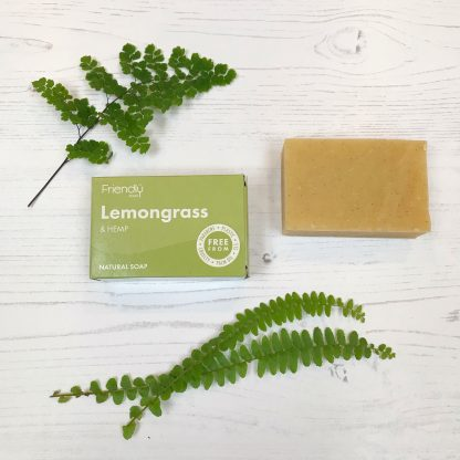 A bar of natural, lemongrass soap with cardboard packaging by Friendly Soap