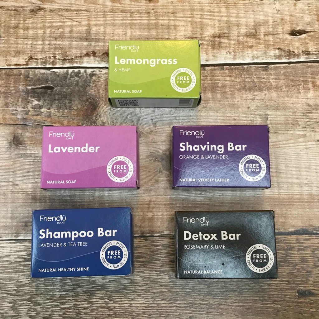 Plastic free toiletries - bars of soap, solid shampoo and shaving bar in brightly coloured cardboard packaging | Sage Folk