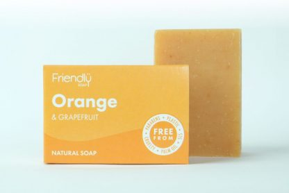 a bar of orange and grapefruit natural soap with recyclable cardboard packaging