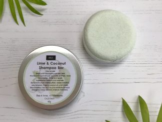 A lime and coconut scented shampoo bar in a round aluminium tin by Bain & Savon | Available at Sage Folk