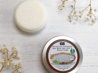 A Sea Salt and Woodsage Shampoo Bar in a Round Tin by Bain & Savon | Available at Sage Folk
