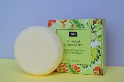 Orange and Bergamot solid shampoo bar in tropical print card presentation box | Available at Sage Folk
